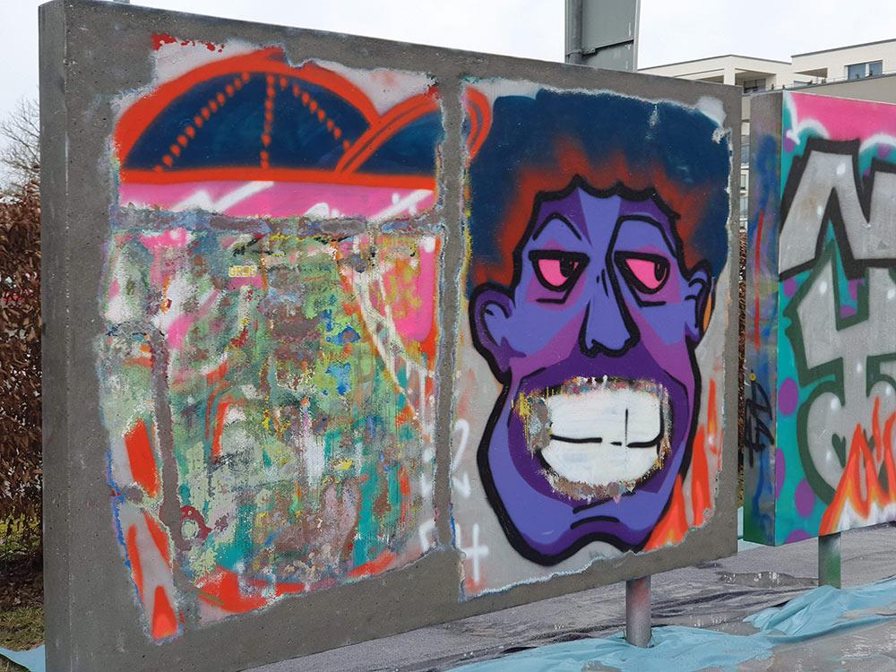 Entfernung von Sprayer Schriftzügen und Graffiti
